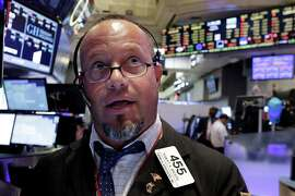 Trader Robert Arciero works on the floor of the New York Stock Exchange, Monday, Aug. 24, 2015. U.S. stocks largely rebounded Tuesday morning, with a gain of around 300 points.