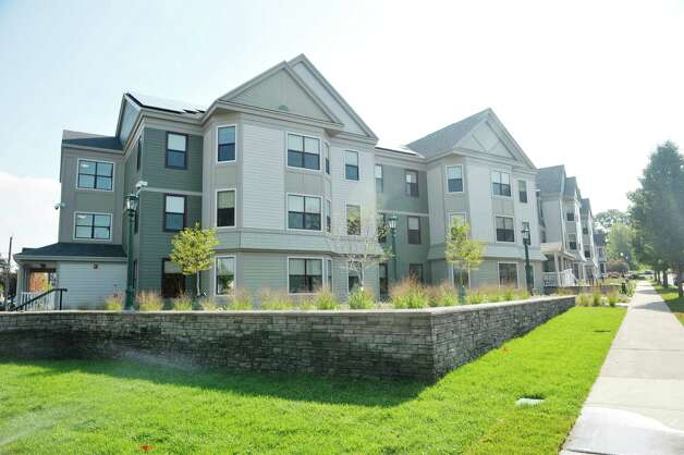 A view of Garnet Commons, the new 80-bed apartment style residence hall at Union College, seen here on Tuesday, Aug. 25, 2015, in Schenectady, N.Y.  The building has 23 apartments broken into fully furnished four-, three-and two-bedroom units.  The building was completed in ten months and it filled up with students through the school's lottery system in 56 minutes.  The space design inside along with the color schemes and furniture were chosen by students through a voting system.  The building is a LEED Silver building.  Building features include a multi-purpose room, lounge, study room, meeting room and music room on the ground floor along with a laundry room.   (Paul Buckowski / Times Union) Photo: PAUL BUCKOWSKI / 00033103A