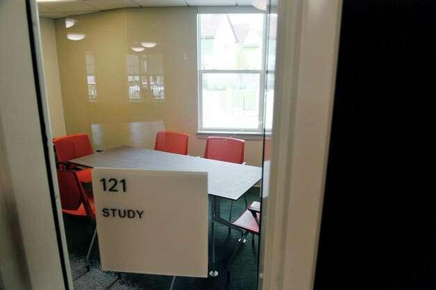 A view of a study room at Garnet Commons, the new 80-bed apartment style residence hall at Union College, seen here on Tuesday, Aug. 25, 2015, in Schenectady, N.Y.  The building has 23 apartments broken into fully furnished four-, three-and two-bedroom units.  The building was completed in ten months and it filled up with students through the school's lottery system in 56 minutes.  The space design inside along with the color schemes and furniture were chosen by students through a voting system.  The building is a LEED Silver building.  Building features include a multi-purpose room, lounge, study room, meeting room and music room on the ground floor along with a laundry room.   (Paul Buckowski / Times Union) Photo: PAUL BUCKOWSKI / 00033103A