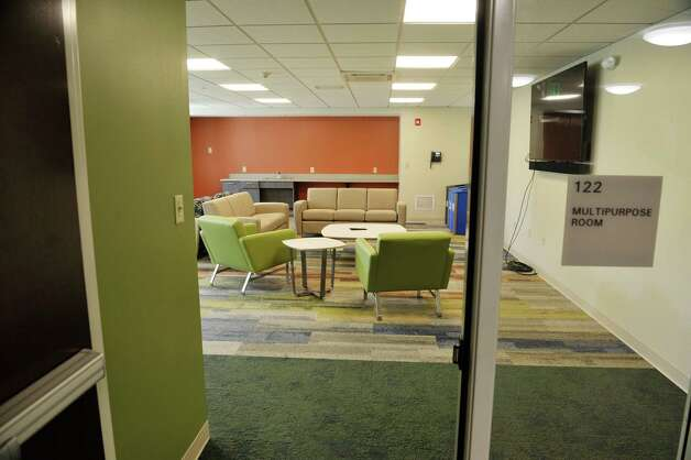 A view of the multipurpose room at Garnet Commons, the new 80-bed apartment style residence hall at Union College, seen here on Tuesday, Aug. 25, 2015, in Schenectady, N.Y.  The building has 23 apartments broken into fully furnished four-, three-and two-bedroom units.  The building was completed in ten months and it filled up with students through the school's lottery system in 56 minutes.  The space design inside along with the color schemes and furniture were chosen by students through a voting system.  The building is a LEED Silver building.  Building features include a multi-purpose room, lounge, study room, meeting room and music room on the ground floor along with a laundry room.   (Paul Buckowski / Times Union) Photo: PAUL BUCKOWSKI / 00033103A