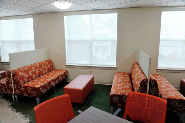 A view of a common area on the second floor at Garnet Commons, the new 80-bed apartment style residence hall at Union College, seen here on Tuesday, Aug. 25, 2015, in Schenectady, N.Y.  The building has 23 apartments broken into fully furnished four-, three-and two-bedroom units.  The building was completed in ten months and it filled up with students through the school's lottery system in 56 minutes.  The space design inside along with the color schemes and furniture were chosen by students through a voting system.  The building is a LEED Silver building.  Building features include a multi-purpose room, lounge, study room, meeting room and music room on the ground floor along with a laundry room.   (Paul Buckowski / Times Union) Photo: PAUL BUCKOWSKI / 00033103A