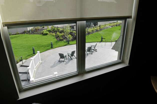 A view of the outside patio from the third floor at Garnet Commons, the new 80-bed apartment style residence hall at Union College, seen here on Tuesday, Aug. 25, 2015, in Schenectady, N.Y.  The building has 23 apartments broken into fully furnished four-, three-and two-bedroom units.  The building was completed in ten months and it filled up with students through the school's lottery system in 56 minutes.  The space design inside along with the color schemes and furniture were chosen by students through a voting system.  The building is a LEED Silver building.  Building features include a multi-purpose room, lounge, study room, meeting room and music room on the ground floor along with a laundry room.   (Paul Buckowski / Times Union) Photo: PAUL BUCKOWSKI / 00033103A