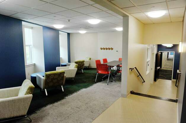 A view of a common area on the third floor at Garnet Commons, the new 80-bed apartment style residence hall at Union College, seen here on Tuesday, Aug. 25, 2015, in Schenectady, N.Y.  The building has 23 apartments broken into fully furnished four-, three-and two-bedroom units.  The building was completed in ten months and it filled up with students through the school's lottery system in 56 minutes.  The space design inside along with the color schemes and furniture were chosen by students through a voting system.  The building is a LEED Silver building.  Building features include a multi-purpose room, lounge, study room, meeting room and music room on the ground floor along with a laundry room.   (Paul Buckowski / Times Union) Photo: PAUL BUCKOWSKI / 00033103A