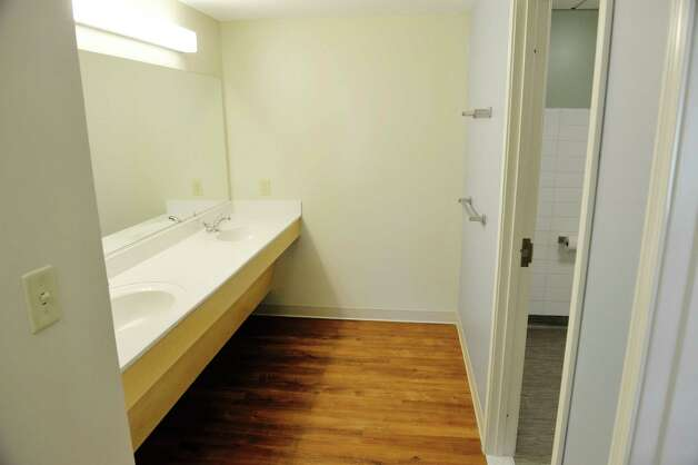 A view of one of double sinks inside an apartment at Garnet Commons, the new 80-bed apartment style residence hall at Union College, seen here on Tuesday, Aug. 25, 2015, in Schenectady, N.Y.  The sinks are located outside the bathroom/shower area so multiple students can be using the area at the same time. The building has 23 apartments broken into fully furnished four-, three-and two-bedroom units.  The building was completed in ten months and it filled up with students through the school's lottery system in 56 minutes.  The space design inside along with the color schemes and furniture were chosen by students through a voting system.  The building is a LEED Silver building.  Building features include a multi-purpose room, lounge, study room, meeting room and music room on the ground floor along with a laundry room.   (Paul Buckowski / Times Union) Photo: PAUL BUCKOWSKI / 00033103A