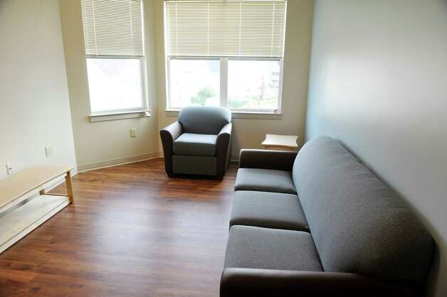 A view inside an apartment at Garnet Commons, the new 80-bed apartment style residence hall at Union College, seen here on Tuesday, Aug. 25, 2015, in Schenectady, N.Y.  The building has 23 apartments broken into fully furnished four-, three-and two-bedroom units.  The building was completed in ten months and it filled up with students through the school's lottery system in 56 minutes.  The space design inside along with the color schemes and furniture were chosen by students through a voting system.  The building is a LEED Silver building.  Building features include a multi-purpose room, lounge, study room, meeting room and music room on the ground floor along with a laundry room.   (Paul Buckowski / Times Union) Photo: PAUL BUCKOWSKI / 00033103A