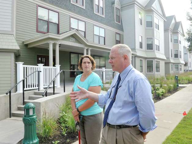 Amanda Bingel, left, Union College director of residential life, and Loren Rucinski, director of facilities and planning for the college, talk about Garnet Commons, the new 80-bed apartment style residence hall at Union College, seen here on Tuesday, Aug. 25, 2015, in Schenectady, N.Y.  The building has 23 apartments broken into fully furnished four-, three-and two-bedroom units.  The building was completed in ten months and it filled up with students through the school's lottery system in 56 minutes.  The space design inside along with the color schemes and furniture were chosen by students through a voting system.  The building is a LEED Silver building.  Building features include a multi-purpose room, lounge, study room, meeting room and music room on the ground floor along with a laundry room.   (Paul Buckowski / Times Union) Photo: PAUL BUCKOWSKI / 00033103A