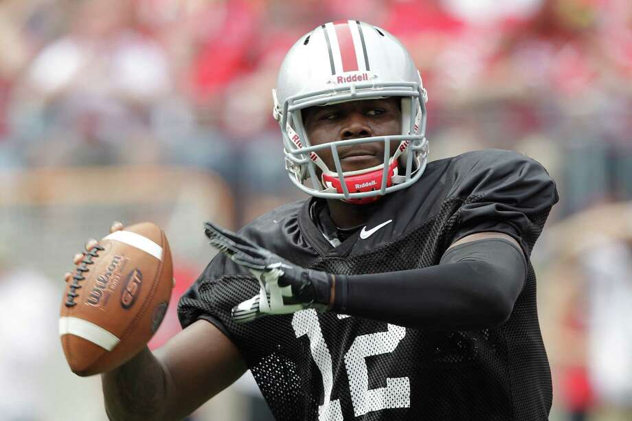 Ohio State quarterback Cardale Jones throws during the team's spring game in Columbus, Ohio, on April 18, 2015. Jones is competing against J.T. Barrett for the starting quarterback spot. Photo: Jay LaPrete /Associated Press / FR52593 AP