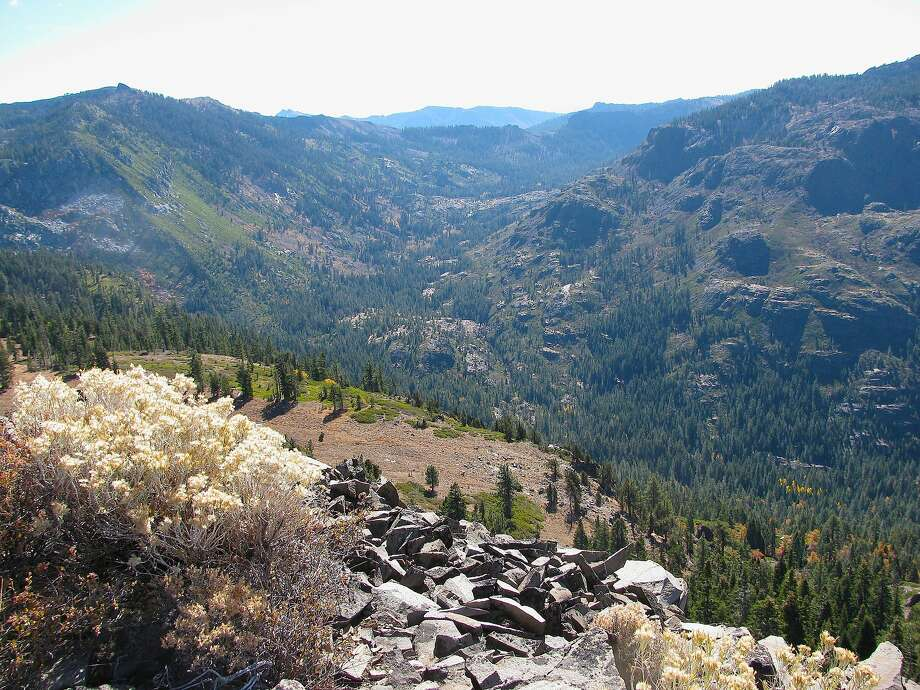 On the west slope of Sierra Crest, with this view from the Tahoe Rim, you can see 10,000 acres of Upper Middle Fork American River headwaters forest in Picayune Valley that The Nature Conservancy, American River Conservancy and Sierra Nevada Partnership bought for $10.1 million in August, 2015, to manage as a living lab to reduce the risk of megafires, improve water quality in drought, and for hiking, camping, horseback riding and fishing Photo: American River Conservancy