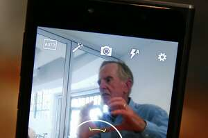 Can former Apple CEO Sculley break into cheap smartphone market? - Photo