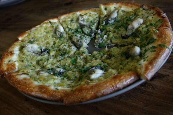 An oyster pizza is served at Osteria Stellina in Point Reyes Station, Calif., on Friday, June 11, 2010. Stellina's chef/owner Christian Caiazzo also owns and operates the coffee bar at Toby's Feed Barn across the street.
