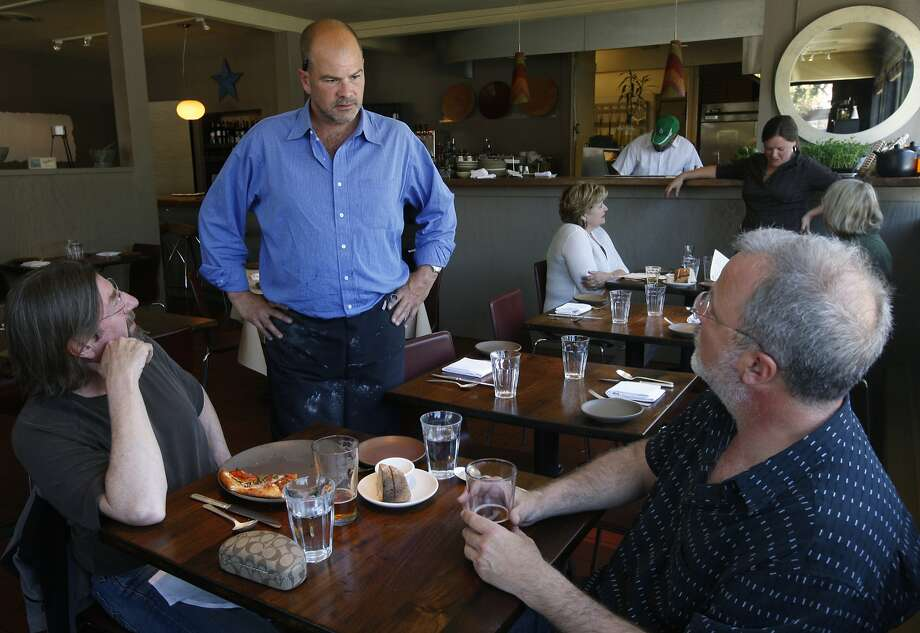 Owner Christian Caiazzo chats with customers at Osteria Stellina in Point Reyes Station. Photo: Paul Chinn, The Chronicle