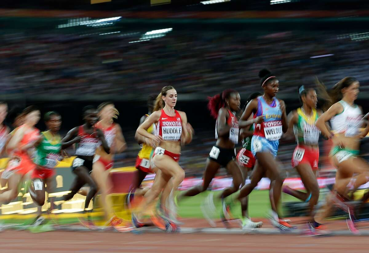 United States' Molly Huddle competes in the women's 10,000m final at the World Athletics Championships at the Bird's Nest stadium in Beijing, Monday, Aug. 24, 2015. (AP Photo/David J. Phillip)