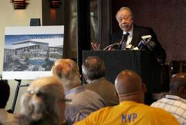 Developer, Floyd Kephart,  next to an artist's conception of what the project may look like, discusses the details of his plan for Coliseum City during a public meeting in Oakland, Calif., on Tues. August 25, 2015.