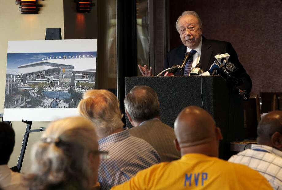 Developer, Floyd Kephart,  next to an artist's conception of what the project may look like, discusses the details of his plan for Coliseum City during a public meeting in Oakland, Calif., on Tues. August 25, 2015. Photo: Michael Macor, The Chronicle