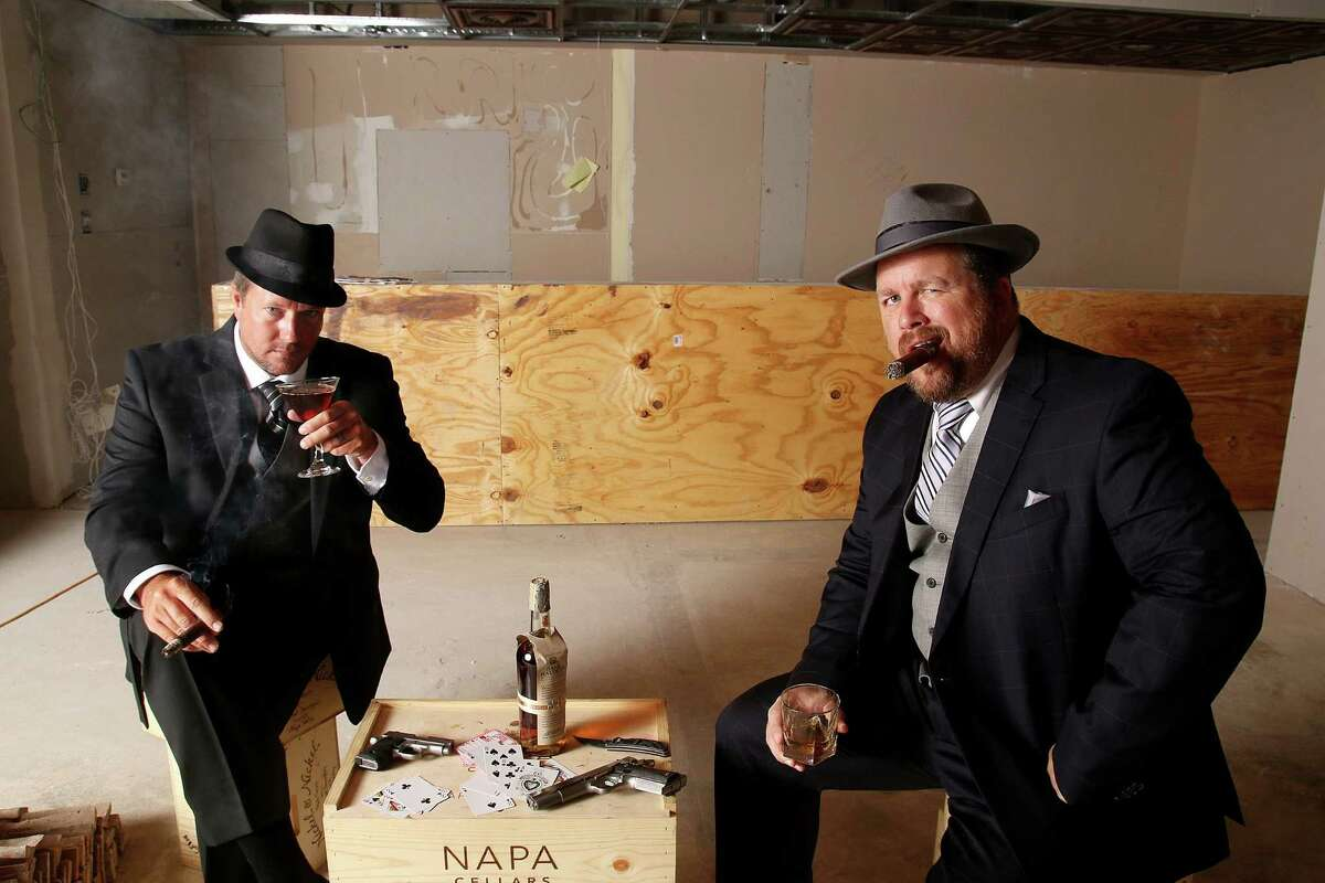 Grazia Italian Kitchen owner Adrian Hembree, left, and manager Larry Bates are adding a bar similar to a Prohibition-era speakeasy, complete with a secret door and jazz music, and they have the gangster duds to dress the part.Grazia Italian Kitchen owner Adrian Hembree, left, and manager Larry Bates are adding a bar similar to a Prohibition-era speakeasy, complete with a secret door and jazz music, and they have the gangster duds to dress the part.