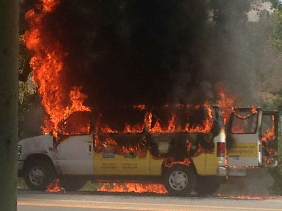 A van in flames on Old Wolf Road near the Exit 4 bridge construction work on Tuesday, Aug. 25, 2015, in Colonie, NY.  (Tim O'Brien/Times Union)