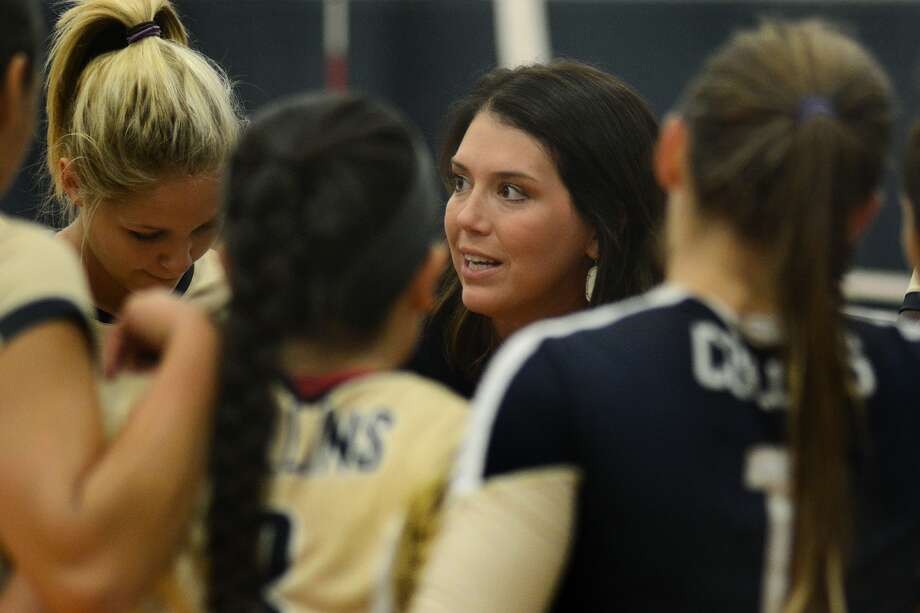 Klein Collins head volleyball coach Amanda McMeans, center, pumps up her team during a timeout against College Park during their season opener at KCHS on Aug. 11, 2015. (Photo by Jerry Baker/Freelance) Photo: Jerry Baker, Freelance