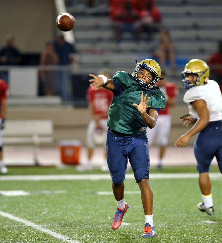 Katy High School visited Klein Collins for a football scrimmage, 8-21-2015. Klein Collins quarterback Rashawn Day, senior, threw a completed pass to one of his receivers. Photo: Eddy Matchette, Freelance / Freelance