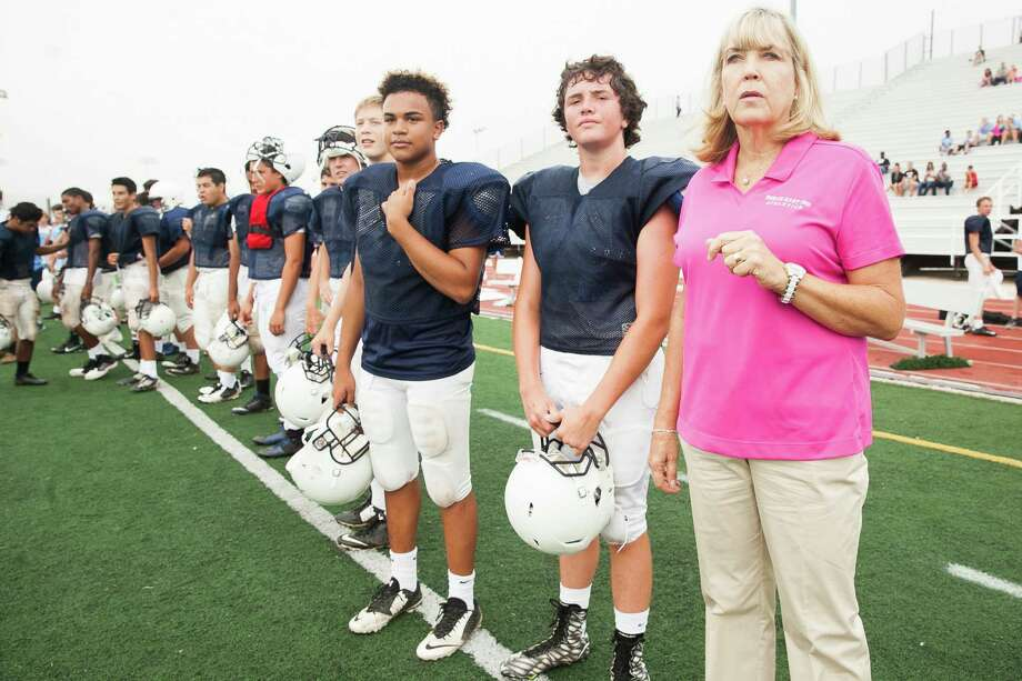 NEISD's Karen Funk watches a Judson-Steele football scrimmage alongside players Friday Aug. 21, 2015, at Comalander Stadium. Funk became the first female high school executive athletic director in San Antonio history in December 2014 after being approved by the North East ISD board of trustees, replacing longtime AD Jerry Comalander, who retired after holding the position since 1988. Photo: Julysa Sosa /For The Express-News / Julysa Sosa For the San Antonio Express-News