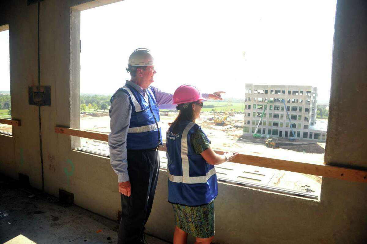 Memorial Herman Hospital, Cypress, TX, construction site. The on going construction is between Mueschke Rd. and Mason Rd. exits on HWY 290 west. Left, Sr. Vice President and CEO Scott Barbe and Director of Business Development Courtney Altimore look at the construction from the Patient Bed Tower, toward the Medical Tower.