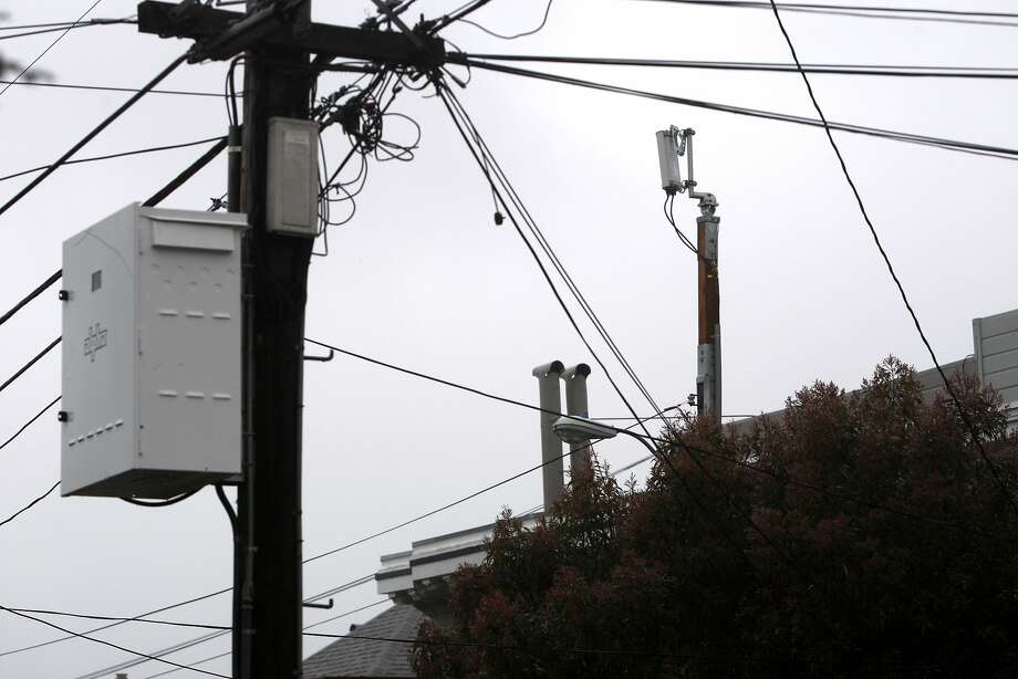 A Next G wireless antenna installed a few months ago reaches over homes and telephone wires in the Sea Cliff neighborhood in San Francisco, Calif., on Sunday, March 6, 2011. On certain days the antenna can reach noise levels of an idling car. Photo: Thomas Levinson, The Chronicle