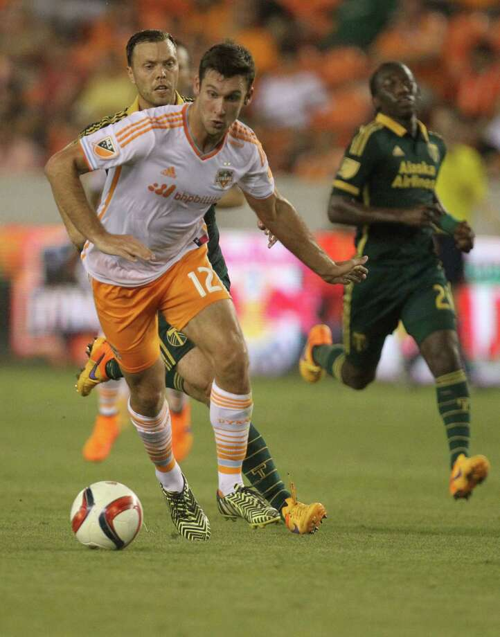 Houston Dynamo forward Will Bruin (12) keeps control of the ball against Portland Timbers midfielder Jack Jewsbury (13), Saturday, May 16, 2015, in Houston. Will Bruin scored two goals for the Houston Dynamo. ( Marie D. De Jesus / Houston Chronicle ) Photo: Marie D. De Jesus, Staff / © 2015 Houston Chronicle