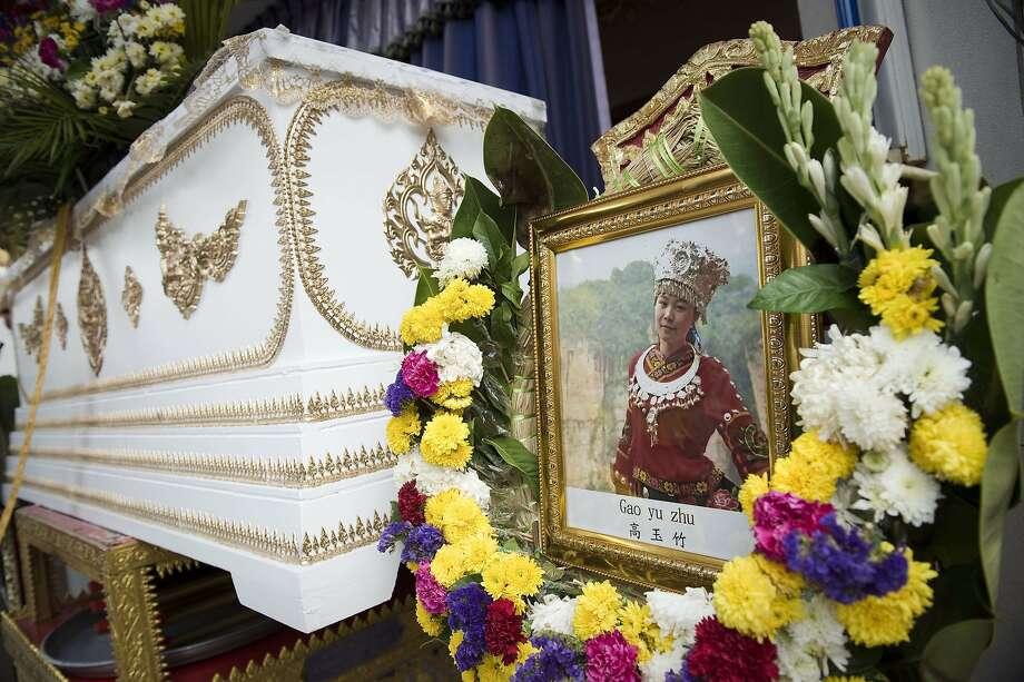 A picture of a Chinese tourist killed in the Aug. 17 bombing stands next to her coffin during a cremation ceremony at a Buddhist temple in Bangkok. Photo: Nicolas Asfouri, AFP / Getty Images