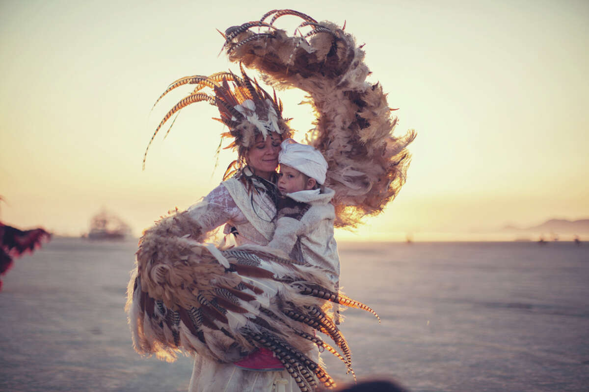 Multimedia artist Zipporah Lomax is documenting children and their parents who attend Burning Man for a fine-art photography book titled 'Dusty Playground.'