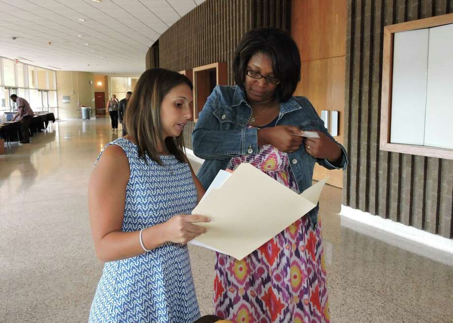 Fort Bend ISD teacher development coordinator Melissa Hubbard, left, assists teacher Latrice Roberts of Drabek Elementary at a recent district orientation for new teachers. The Fort Bend Education Foundation sponsored a keynote speaker and distributed classroom gift certificates. Fort Bend ISD teacher development coordinator Melissa Hubbard, left, assists teacher Latrice Roberts of Drabek Elementary at a recent district orientation for new teachers. The Fort Bend Education Foundation sponsored a keynote speaker and distributed classroom gift certificates. Photo: FBISD