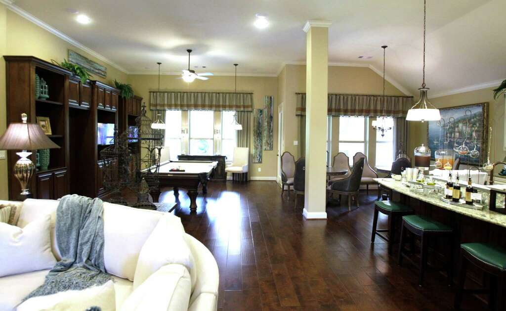 A home in Bonterra at Woodforest includes additional space called a Texas  entertainment area. Photo