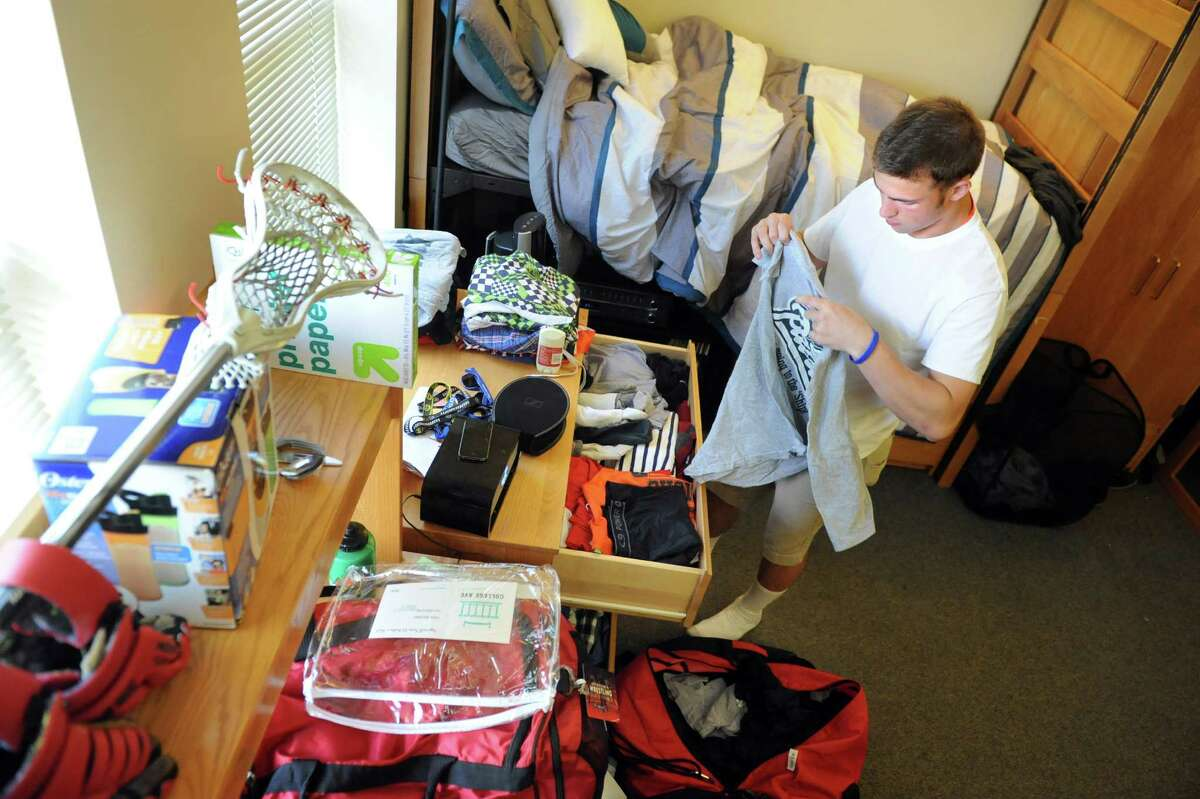 Freshman Rhys Jacobson, 18, of Milford, Mass. unpacks his clothes as he settles into his dorm on Tuesday, Aug. 25, 2015, at Rensselaer Polytechnic Institute in Troy, N.Y. (Cindy Schultz / Times Union)