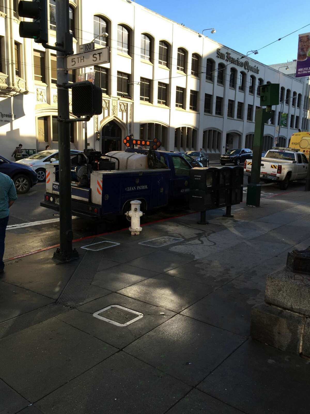 A San Francisco Clean Patrol truck finishes hosing down the sidewalk across the street from the San Francisco Chronicle and SFGATE building after tweets of homeless men defecating on the streets go viral.