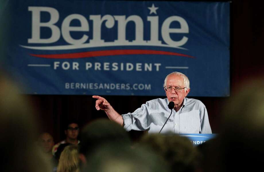 Democratic presidential candidate Sen. Bernie Sanders speaks at a town hall meeting in Salem, N.H. A reader says both Sanders and Donald Trumph will alter politics as usual with their refreshing candor. Photo: Cheryl Senter /Associated Press / FR62846 AP