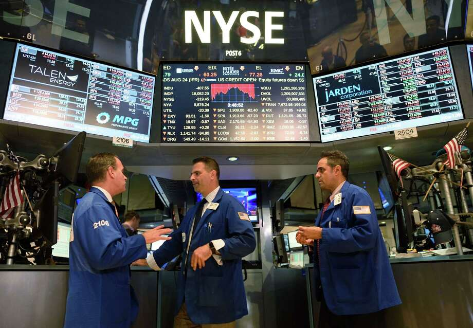 Traders are shown on the floor of the New York Stock Exchange on Monday. The market turmoil make voters pay more attention to the candidates' records on economic and financial management — and might give a boost to those with experience, as opposed to promise. Photo: Don Emmert /AFP / Getty Images / AFP