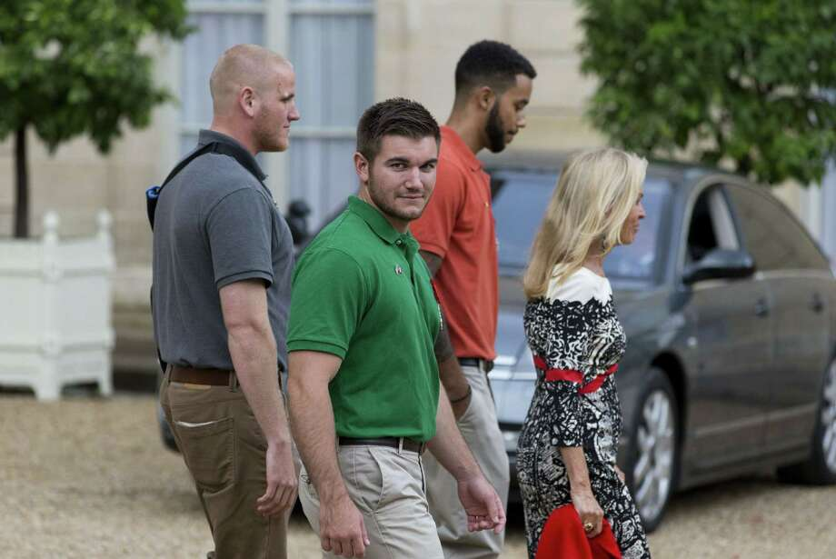 Americans (from left) Spencer Stone, Alek Skarlatos and Anthony Sadler seem surprised at the praise coming their way. Photo: Kenzo Tribouillard /AFP / Getty Images / AFP