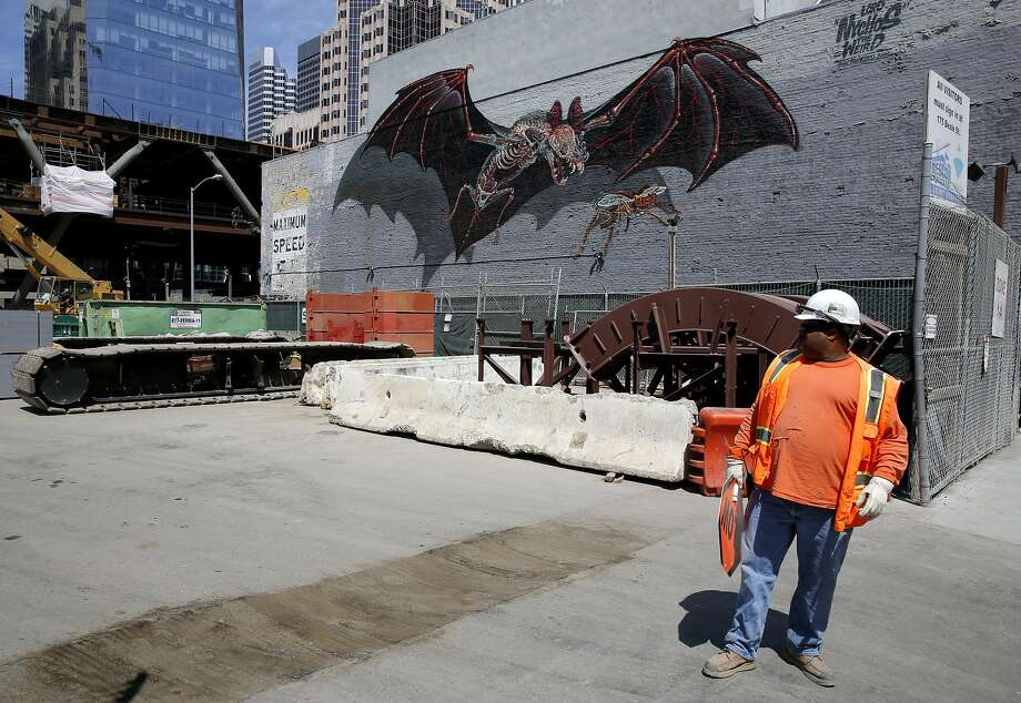 A mural of a bat on the wall of a building next to a construction site on Howard Street near Second in S.F. Photo: Connor Radnovich, The Chronicle