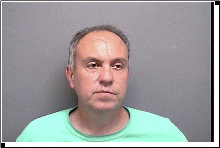 Joel Mackinnon, 48, of Stamford faces a single count of first-degree larceny, eight counts of third degree larceny and other charges in connection with reported car thefts near Patton Drive. Photo: Contributed / Contributed Photo / Darien News