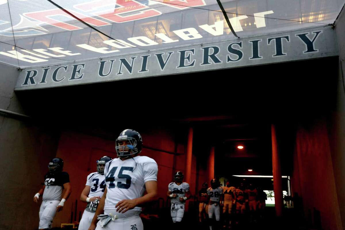 Players exit the tunnel before the start of the Rice University Blue Gray spring football game at Rice Stadium Friday, April 10, 2015, in Houston, Texas. ( Gary Coronado / Houston Chronicle )
