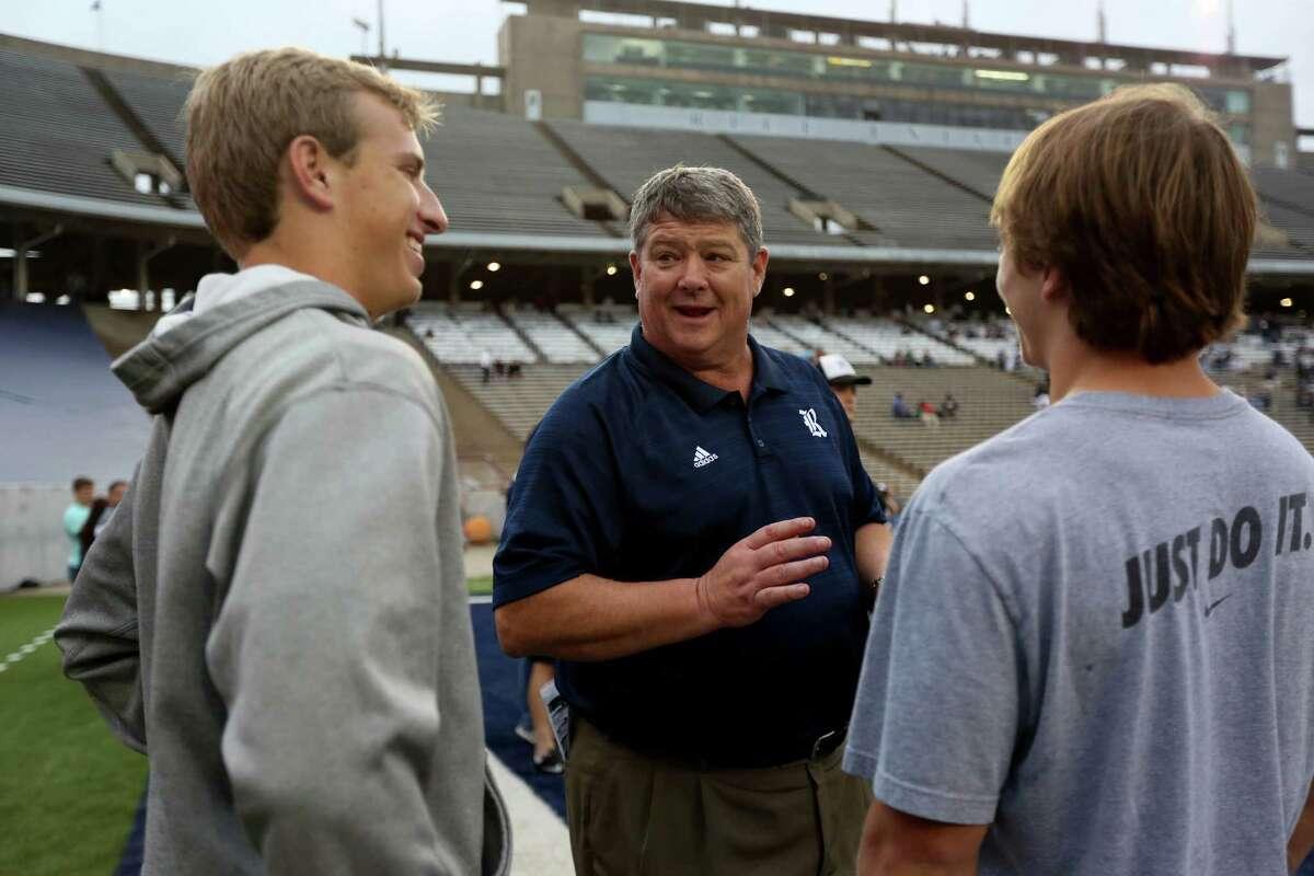 Head coach David Bailiff, center, with recruits before the start of the Rice University Blue Gray spring football game at Rice Stadium Friday, April 10, 2015, in Houston, Texas. ( Gary Coronado / Houston Chronicle )