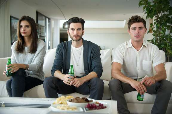 "This photo provided by Warner Bros. Pictures shows Emily Ratajkowski, from left, Wes Bentley, and Zac Efron in a scene from Warner Bros. Pictures' and Studiocanal's romantic drama, ""We are Your Friends."" (Anne Marie Fox/Warner Bros. Pictures via AP)"