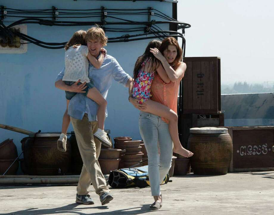 "In this image released by The Weinstein Company, Owen Wilson, left, and Lake Bell appear in a scene from, ""No Escape."" (Roland Neveu/The Weinstein Company via AP) ORG XMIT: NYET601 Photo: Roland Neveu / The Weinstein Company"