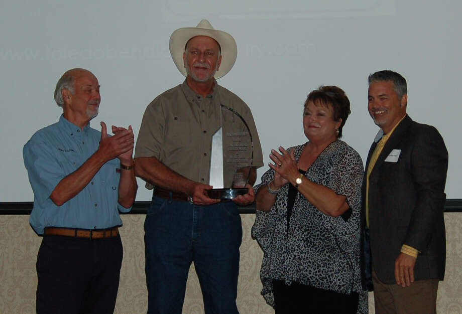 James Hall, Editor of Bassmaster Magazine (Right) presents the plaque of recognition for Toledo Bend being named the #1 bass lake in the country.  (L-R) Toledo Bend Lake Association President John Toliver, Sabine River Authority Director Jim Pratt and Sabine Parish Tourist Commission Director Linda Curtis-Sparks accepts the award on behalf of the community and everyone who had a part of making this honor and achievement happen Photo by Patty Lenderman / Lakecaster