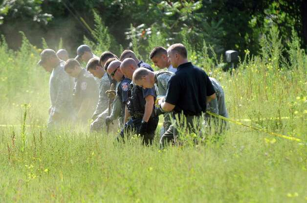 Colonie Police and EMS search for evidence at Everett and Sand Creek roads on Tuesday, Aug. 25, 2015, Colonie, N.Y. They were searching near the area where salon worker Jacquelyn Porreca, 32, was stabbed and killed on Friday. (Cindy Schultz / Times Union) Photo: Cindy Schultz / 00033123A