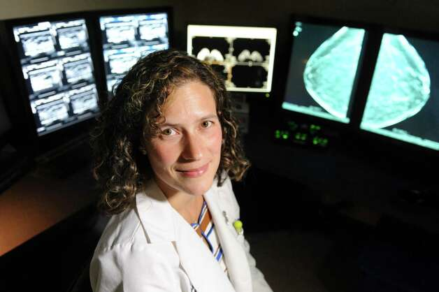 Dr. Beth Whiteside with mammogram images on Tuesday, July 28, 2015, at Albany Medical Center South Clinical Campus in Albany, N.Y. (Cindy Schultz / Times Union) Photo: Cindy Schultz / 00032752A