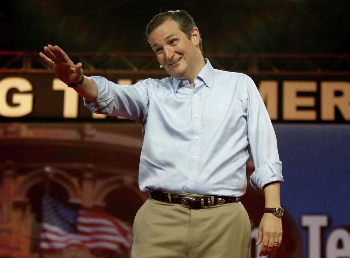 Republican presidential candidate, Sen. Ted Cruz, R-Texas, waves to the crowd at the Defending the American Dream summit hosted by Americans for Prosperity at the Greater Columbus Convention Center in Columbus, Ohio, Saturday, Aug. 22, 2015. (AP Photo/Paul Vernon)