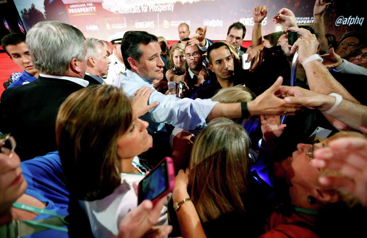 Republican presidential candidate, Sen. Ted Cruz, R-Texas, greets supporters after speaking at the Defending the American Dream summit hosted by Americans for Prosperity at the Greater Columbus Convention Center in Columbus, Ohio, Saturday, Aug. 22, 2015. (AP Photo/Paul Vernon)