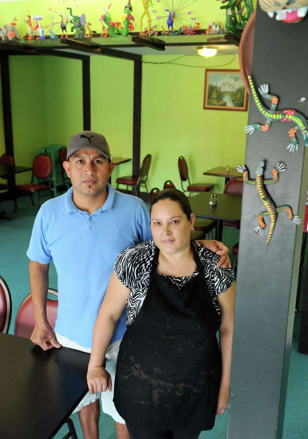 Everardo Sosa-Mendoza and his wife, Maria Sosa owners of La Mexicana restaurant and grocery store on Tuesday Oct. 1, 2013 in Schenectady, N.Y. (Michael P. Farrell/Times Union)