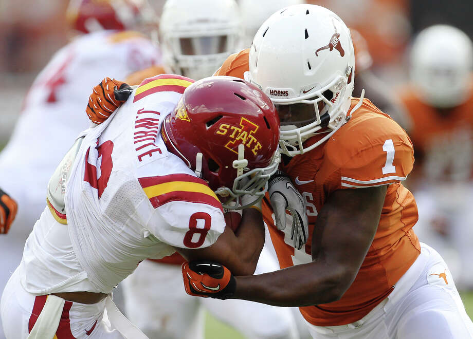Texas Longhorns' Shiro Davis (01) makes a stop against Iowa State's James White (08) in the second half at Darrell K. Royal Stadium in Austin on Saturday, Nov. 10, 2012. Texas defeated Iowa State, 33-7. Photo: Kin Man Hui, Staff / San Antonio Express-News / © 2012 San Antonio Express-News