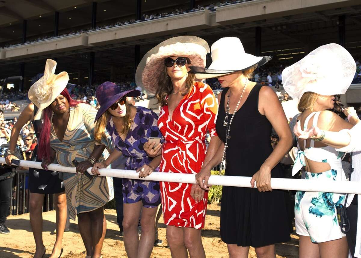FILE - In this July 16, 2015 file photo provided by Benoit Photo, Caitlyn Jenner, center, stands trackside to watch the seventh race as the Del Mar Thoroughbred Club opened is annual summer meet in Del Mar, Calif. Jenner's docuseries,