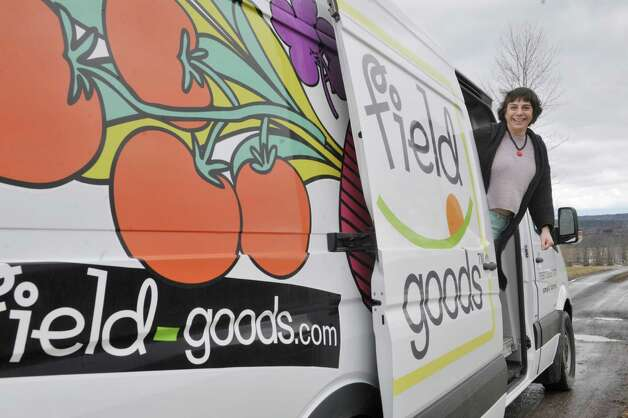 Donna Williams, the Founder & President of Field Goods, poses for a photograph with one of the delivery trucks they use on Tuesday, March 17, 2015, in Athens, N.Y.  (Paul Buckowski / Times Union) Photo: PAUL BUCKOWSKI / 00031008A